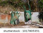 Two Old Rusty Wheelbarrows In...