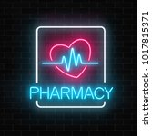 neon pharmacy glowing signboard ... | Shutterstock .eps vector #1017815371