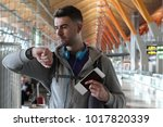 traveler checking the time at...   Shutterstock . vector #1017820339