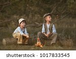 boys fry sausages in the woods...   Shutterstock . vector #1017833545