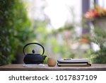 black vintage teapot and... | Shutterstock . vector #1017837109