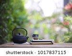 black vintage teapot and... | Shutterstock . vector #1017837115