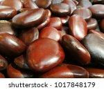Small photo of Shiny Brown color grains of Entada Rhudii close up