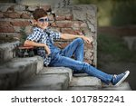 portrait of a teenage boy with... | Shutterstock . vector #1017852241