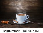 a cup of hot coffee on a dark... | Shutterstock . vector #1017875161