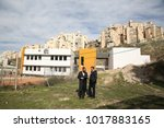 Small photo of SAFED, ISRAEL - JAN 11, 2018: Mayor Ilan Shochat and Rabbi Nachman Gelbach, city official. In the backround is a new school in Safed/Tzfat, Israel