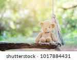teddy bear alone on a wooden... | Shutterstock . vector #1017884431