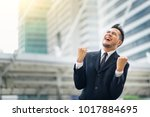 excited young asian businessman ... | Shutterstock . vector #1017884695