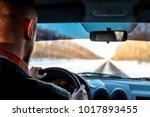 job driver. man drives a car in ... | Shutterstock . vector #1017893455