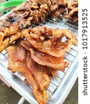 Small photo of Asian Traditional Street Food with grilled pork intestine and duck, lamb, liver, chicken offal in a shop on local market in Bangkok, Thai style barbecue.
