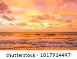 sunset and beach beautiful... | Shutterstock . vector #1017914497