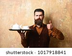 barman with strict face serves... | Shutterstock . vector #1017918841