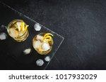 whiskey on the rocks with lemon ... | Shutterstock . vector #1017932029