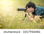 young asian male photographer... | Shutterstock . vector #1017936481