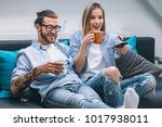 young couple sitting on the... | Shutterstock . vector #1017938011