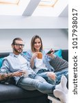 young couple sitting on the... | Shutterstock . vector #1017938017