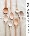 Small photo of concept of kitchen and food with copy space empty design wooden spoons on natural linen for quantity, dosage and health in cuisine, above view