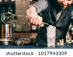 Small photo of Barman details - pouring rum into drink, alcoholic drink preparation