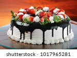 strawberry cake with chocolate... | Shutterstock . vector #1017965281