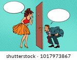 man and woman looking through a ... | Shutterstock .eps vector #1017973867
