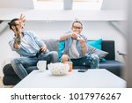 young couple playing video... | Shutterstock . vector #1017976267