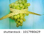 green grape and measure tape | Shutterstock . vector #1017980629
