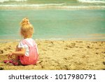 baby girl playing in the sand... | Shutterstock . vector #1017980791