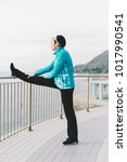 attractive woman stretching... | Shutterstock . vector #1017990541