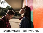 lesbian couple having a... | Shutterstock . vector #1017992707