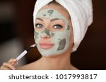 beautiful woman having clay... | Shutterstock . vector #1017993817