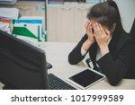 asian businesswoman stress from ... | Shutterstock . vector #1017999589