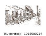 street with houses in goa ... | Shutterstock .eps vector #1018000219