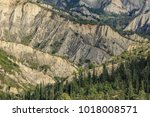 badlands and pine trees | Shutterstock . vector #1018008571