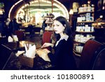 young woman in cafe | Shutterstock . vector #101800891