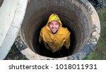 man is inside sewage pit ... | Shutterstock . vector #1018011931