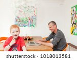 father and son in dining room | Shutterstock . vector #1018013581