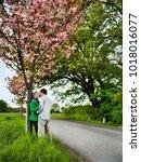 couple kissing on rural road   Shutterstock . vector #1018016077
