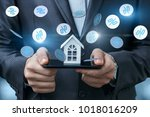 Small photo of Layout of the house in the phone and fly interest. The concept of discounts on real estate.