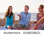 people relaxing together on... | Shutterstock . vector #1018018621