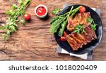 barbecue spare ribs on an... | Shutterstock . vector #1018020409
