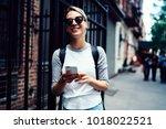 happy hipster girl sending... | Shutterstock . vector #1018022521