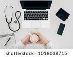 partial view of doctor at... | Shutterstock . vector #1018038715