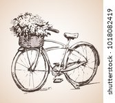 bike with big bunch of flowers. ... | Shutterstock .eps vector #1018082419