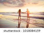 young girls have fun on a beach | Shutterstock . vector #1018084159
