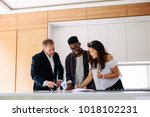 couple signing a contract... | Shutterstock . vector #1018102231
