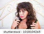 closeup of upset mature woman...   Shutterstock . vector #1018104265