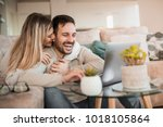 young couple relaxing on sofa... | Shutterstock . vector #1018105864