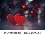 Two Red Hearts Against Holiday...