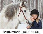 little girl with a friesian... | Shutterstock . vector #1018118131