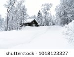 snow covered trees and wooden... | Shutterstock . vector #1018123327